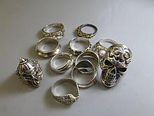 An assortment of mostly silver rings.