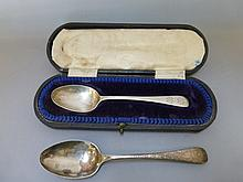 A cased silver spoon and one other silver spoon.
