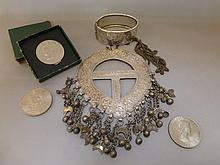 A Turkish white metal pendant necklace of unusual