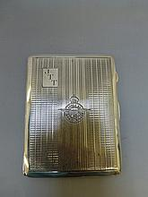 A silver cigarette case with engine turned