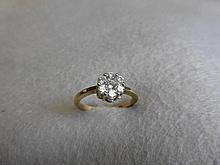 A 9ct gold seven stone diamond flower petal