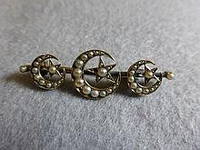 A Victorian 15ct gold seed pearl moon and star