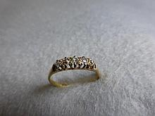 An 18ct gold five stone old cut diamond ring, 0.3