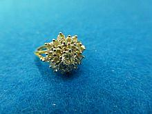 An 18ct gold 25 stone diamond cluster ring,