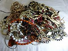 A box of assorted costume jewellery.