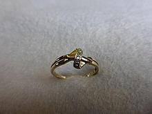 A 9ct gold and diamond ring, size P.