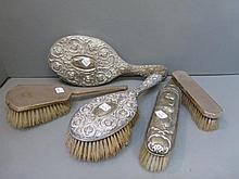 Five silver backed dressing table accessories