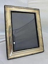 A silver photograph frame, maker K.F. Ltd. London