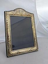 A decorative silver photograph frame, maker RC,