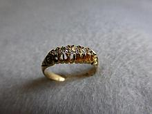 An 18ct gold five stone diamond ring, 0.4 carats,
