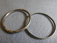 A sterling silver bangle signed by Charles Horner