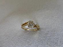 A 9ct gold and diamond set ring.