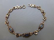 A 9ct gold and opal set bracelet.