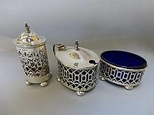 A three piece silver cruet set, two with liners,