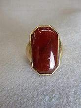 An Art Deco Cornelian set gold ring.