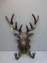 A set of coat hooks in the form of stag heads.