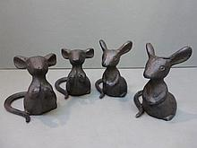 A collection of four cast metal garden mice.