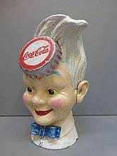 A reproduction cast metal Coca Cola branded money