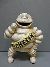 A cast metal standing Michellin Mr. Bibendum.