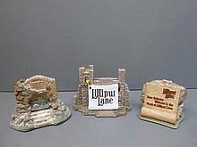 Three Lilliput Lane shop display plaques.