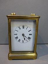 A 19th Century brass carriage clock stamped 'R &