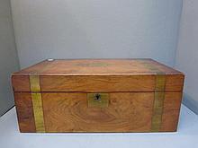 A 19th Century walnut and brass bound writing