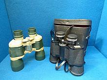 Two pairs of binoculars.