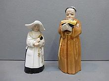 A pair of Royal Worcester extinguisher figures: a