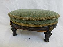 An Edwardian ebonised and upholstered footstool