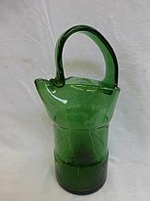An unusual green glass jug with shaped handle.