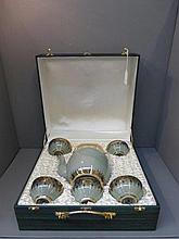 A decorative cased five setting Taiwanese Celadon