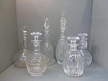 Six glass decanters including two ring neck