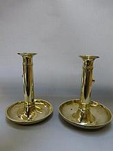 A pair of 18th Century brass candlesticks with