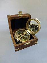 A reproduction cased brass Breton compass, stamped