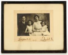 ROYALTY- George VI, King and Queen Elizabeth the Queen Mother. A photograph by Marcus Adams mounted on card and SIGNED on the photo in pencil by Adams, dated 1936, depicting the Royal couple with Princess's Elizabeth and Margaret.  SIGNED on the card by George V and the Queen Mother and dated 1937. Framed and glazed. Dimensions of the frame: 220mm x 170mm. Adams' 1934 photograph of Princess Elizabeth at the age of 8 was used as the portrait for the $20 banknote.