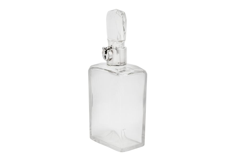A George V sterling silver mounted lockable decanter, Birmingham 1923 by Hukin and Heath