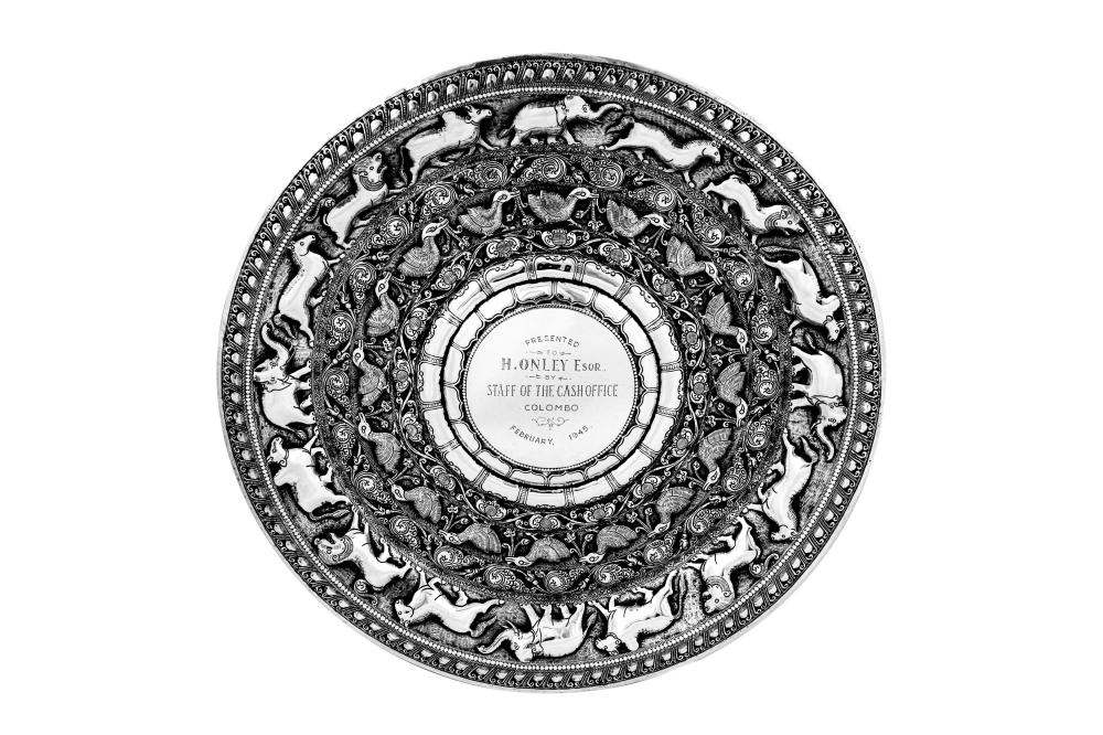 A large mid-20th century Ceylonese (Sri Lankan) silver moonstone charger or tray, Kandy or Colombo dated 1945