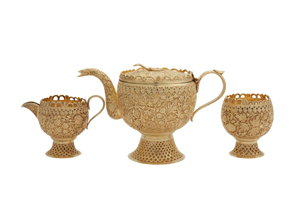 An early 20th century Anglo - Indian unmarked silver gilt three-piece tea service, Kashmir circa 1900