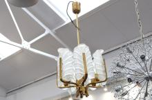 A 1960'S CHANDELIER ATTRIBUTED TO CARL FAGERLUND FOR ORREFORS SWEDEN, with frosted acanthus leaf form glass appliques, on brass frame (38cm diameter).