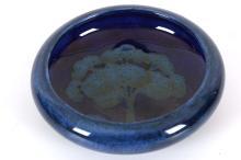 WILLIAM MOORCROFT 'MOONLIT BLUE' DISH, CIRCA 1925, with inverted rim, impressed marks under, (10.7cm diameter)