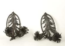 ATTRIBUTED TO EMILE ROBERT, a pair of 1930s French black enamelled wrought iron, twin light wall sconces, (30cm high)