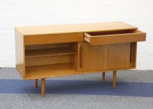 A 1950s HILLEPLAN SIDEBOARD, DESIGNED BY ROBIN DAY FOR HILLE, with two frieze drawers above double cupboard with sliding doors, (137 x 45.5 x 76.5cm high)