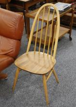 A SET OF FOUR 1960'S ERCOL BEECH AND ELM DINING CHAIRS (97cm high).