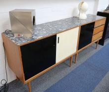 A pair of 1960's Owen Thornell sideboards, withformica top, and black and white doors, 107cm wide