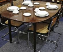 A 1960'S MAHOGANY EXTENDING DINING TABLE, designed by Ole Wanscher and manufactured by P. Jepsen, with two extension leaves, bears maker's label under.
