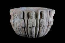 A 12TH CENTURY BYZANTINE CARVED STONE HOLY WATER VESSEL DEPICTING THE TWELVE APOSTLES  carved in relief with the figures of the twelve Apostles in prayer and each with a book, possibly adapted from a capital, repaired,  30cm diameter x 20cm high   Provenance: Property of a European gentleman.   THIS LOT WILL BE ON DISPLAY AT OUR SOUTH KENSINGTON GALLERY UNTIL 14TH MARCH AND AT OUR CHISWICK SALEROOM FROM 16TH - 21ST MARCH.