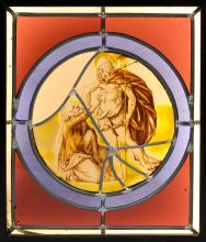 A 17TH CENTURY STAINED AND LEADED GLASS PANEL DEPICTING DOUBTING THOMAS  of circular form, within a later red and blue glass mount and mounted in a modern black frame with electric light to illuminate,  the glass 17cm diameter, the frame 38cm high