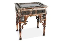 A RARE 19TH CENTURY OTTOMAN EBONY, TEAK, IVORY, BONE & MOTHER OF PEARL MASHRABIYA BIJOUTERIE TABLE  decorated throughout with geometric inlay and carved wood lattice-work, the hinged and glazed rectangular top opening to reveal the cabinet within,  74cm wide x 82cm high x 53cm deep   PLEASE NOTE THIS LOT IS SUBJECT TO CITES