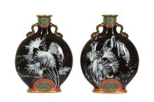 A FINE PAIR OF MINTONS PATE-SUR-PATE MOON FLASKS IN THE MANNER OF MARK LOUIS SOLON, CIRCA 1885  the bodies decorated with various flowers and trailing leaves with a butterfly to one vase and a moth to the other on a dark brown ground, the foliage extending to the reverse of each vase, the neck and foot with gilt decoration and a fan shaped design on a salmon ground, both with impressed 'MINTONS' mark, model number 1348,  19.5cm high (2)   For a similar pair of Minton moonflasks signed by Louis Solon, see Bonhams, London, 17 May 2017, lot 412.