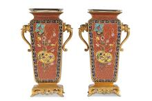 A PAIR OF LATE 19TH CENTURY FRENCH GILT BRONZE AND CHAMPLEVE ENAMEL VASES IN THE MANNER OF BARBEDIENNE  the geometric vases with everted rectangular lips over inswept necks, the bodies with scrolling handles modelled with dragons, raised on rectangular pierced plinths, with glass liners,  18.5cm high (2)